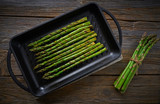 asparagus grilled on cast iron grill pan on wood - 207804813