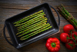asparagus grilled on cast iron grill pan on wood - 207804837
