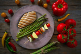 grilled chicken breast with brochette vegetable - 207804892
