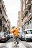 Happy man walking down a street in Madrid - 207805645