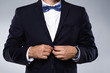 Man in navy blue suit with bow tie