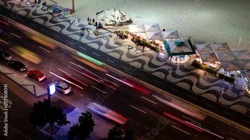 Time Lapse Of Night Traffic On Copacabana beach next to the kiosks, Rio de Janeiro, Brazil