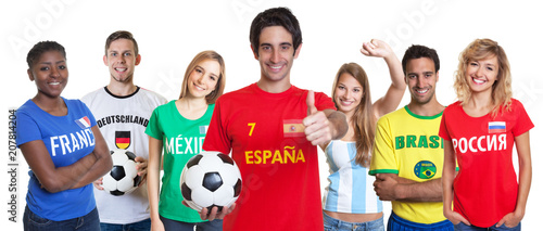 Cheerful spanish soccer fan with cheering group of other fans