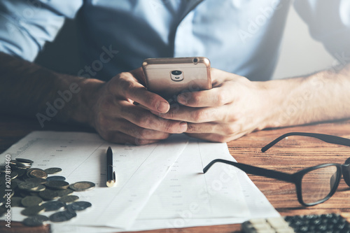 Businessmen hand phone with document