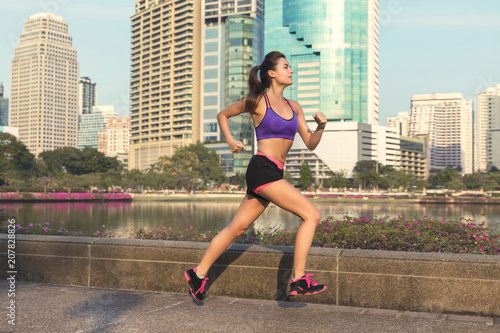Woman in the city during her running workout