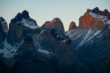 Mountains covered with snow at sunset. Part of mountains of Torres del Paine National Park during sunset, Chile
