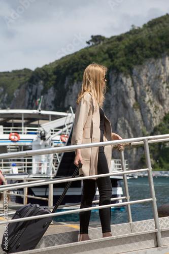 Fototapeta Young woman boarding the ferry
