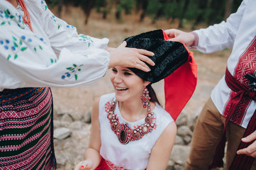 National Ukrainian traditions. The bride is put on a Cossack hat. Wedding in ethnic style. Initiation into the Cossacks.