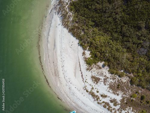 Canvas Khaki beach aerial drone above view white sand boats sea water island