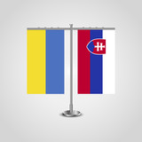 Table stand with flags of Ukraine and Slovakia.Two flag. Flag pole. Symbolizing the cooperation between the two countries. Table flags