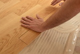 close up of worker installing wood parquet - 207880018