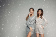 Two women wearing in stylish clothes preparing for christmas party.