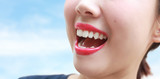 Woman mouth smile with great teeth over blue background.