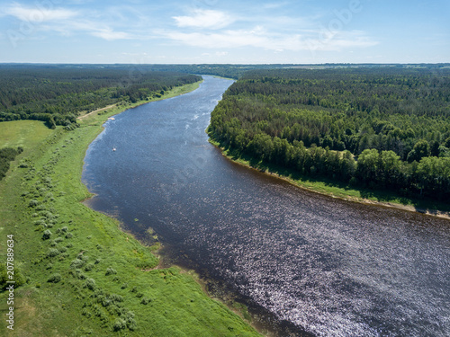 Canvas Blauwe hemel drone image. aerial view of Daugava river, largest in Latvia