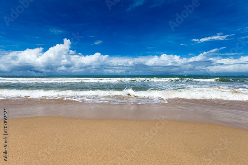 Sea view from tropical beach with sunny sky. Summer paradise beach