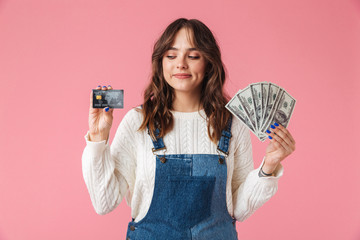 Portrait of a confident young girl holding money banknotes