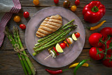 grilled chicken breast with brochette vegetable - 207894881