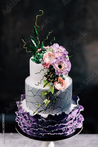 Closeup of white wedding cake with flowers on top cake on the cake closeup of white wedding cake with flowers on top cake on the cake shelf mightylinksfo