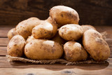 fresh potatoes on a wooden table - 207898699
