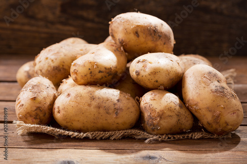 fresh potatoes on a wooden table