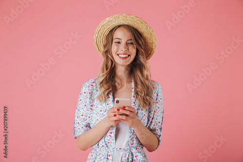 Leinwanddruck Bild Portrait of a cheerful young woman in summer dress