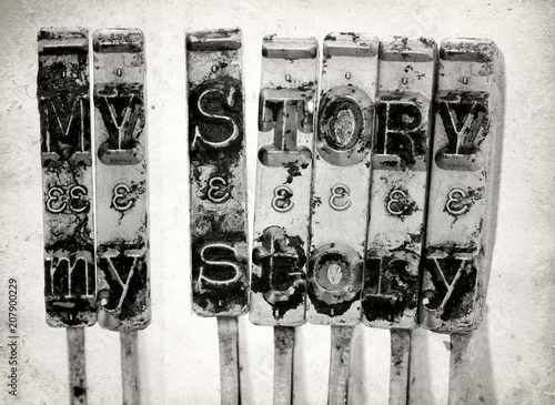 The words  MY STORY  with old typewriter hammers - 207900229