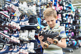 Boy with rollers in store - 207901860