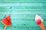 Watermelon popsicle and ice cream cone on blue planks background with copy space, summer concept - 207906053