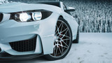 white car in the snow. - 207913875