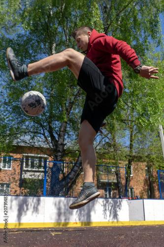 Fotobehang Voetbal teenager playing football