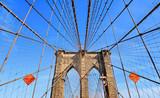 brooklyn bridge and modern patterns against blue sky in Manhattan, Ney York - 207915025