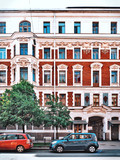 The facade of the historic old building with sculptures in St. Petersburg - 207917028
