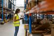Leinwanddruck Bild - Scanning the goods in warehouse