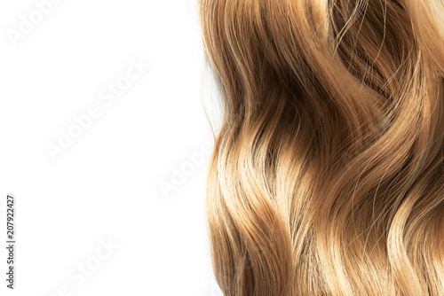long blond wavy hair isolated on white background