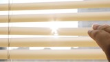 Woman open and close blinds on the window - 207924842