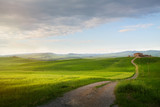 village in tuscany; Italy countryside landscape with Tuscany rolling hills ; sunset over the farm land and country road - 207927408