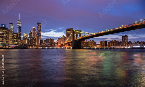 New York city USA. Sunset over Manhattan and Brooklyn bridge © Olesya