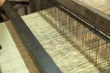 Weaving silk in traditional way in Vietnam. Vietnamese silk processing. - 207943664
