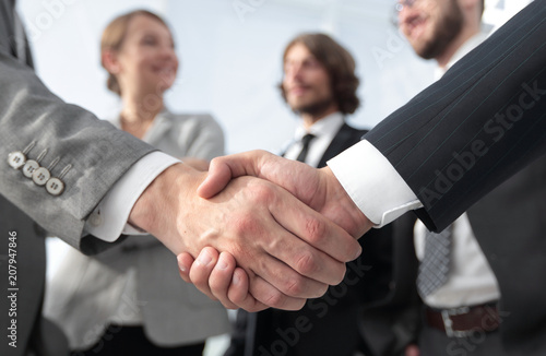 welcome and handshake business people - 207947846