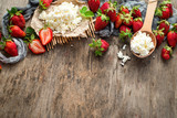 Fresh sweet cherries and strawberries with cottage cheese on wooden background. Top view. Copy space. Flatlay - 207951436