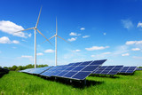 Solar panel on blue sky background. Green grass and cloudy sky. Alternative energy concept - 207975265
