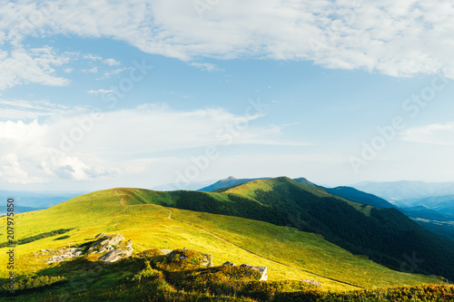 View of the stony hills glowing by evening sunlight. Dramatic spring scene. Chornohora ridge, Carpathians, Ukraine, Europe.