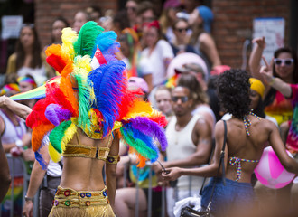 Participant dressed in flamboyant carnival costume participates in annual Pride Parade as it passes through Greenwich Village.