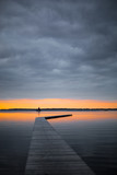 beautiful dawn with a wooden dock and a sailing boat   Zuidlaardermeer, Netherlands - 207998807