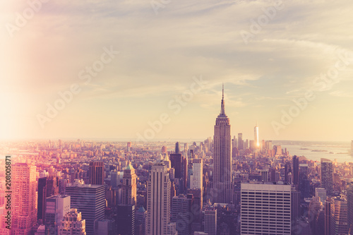 Vintage style image of buildings across New York City at sunset with retro filter