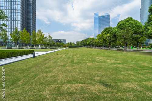 Fotobehang Shanghai beautiful green field near modern office building.