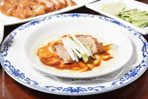 Plexiglas Peking Peking Duck - Chinese roast duck served with spring onion and hoisin sauce, wrapped in pancakes.