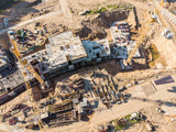 two cranes working on big construction site. aerial view - 208017441