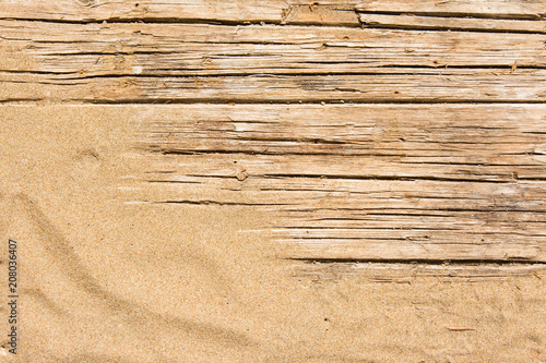 Fototapeta Sand on planked wood. Summer background with copy space. Top view