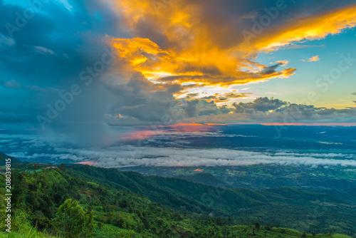 Fotobehang Groen blauw mountains under mist in the morning with sunrise at Phu Tub Berk, Petchabun Thailand